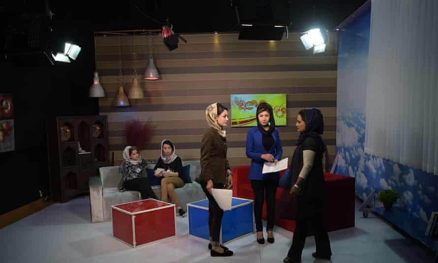 Presenters discuss the news before broadcast of Zan TV's morning programme.