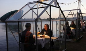 'Quarantine greenhouses' are being tested at a restaurant in Amsterdam to allow customers to eat out in a safe environment.