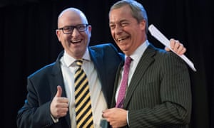 Paul Nuttall (left) is one of the other seven Ukip MEPs also being investigated by the European parliament alongside Nigel Farage (right).