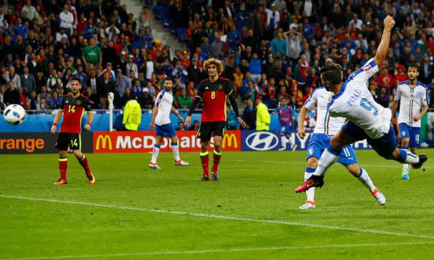 Graziano Pellè volleys home Italy's clincher against Belgium.