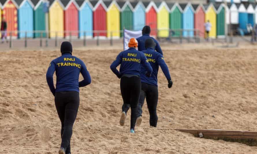 RNLI lifeguards in training on Boscombe beach