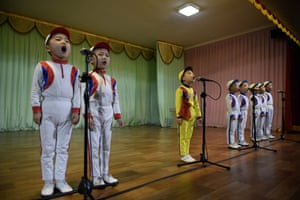 Smiling children in bright costumes and makeup belt out the finale of their hour-long show: We Cannot Live Without You, Father, an ode to Kim Jong-un.