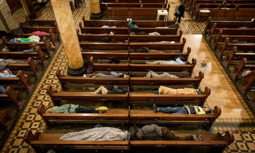 Homeless people sleep in the pews at St Boniface Catholic Church in the San Francisco Tenderloin area, as part of the Gubbio Project.