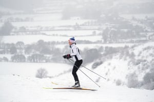 A woman takes advantage of the snow with a spot of skiing in Wye National Nature Reserve, near Ashford in Kent