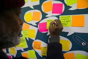 Tee writes a suggestion on a public notice board at the Waterloo Public Housing Action Group HQ