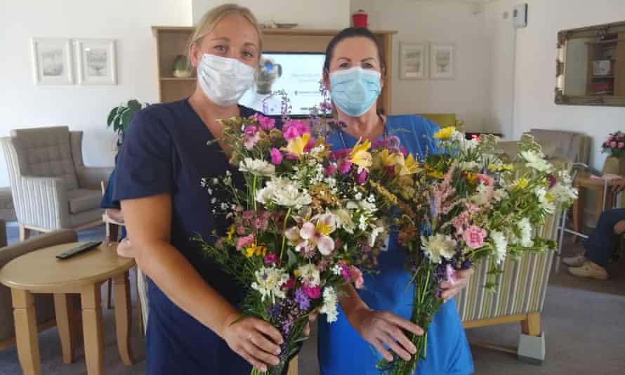 Staff at the Madeline McKenna Court care home receive Wonky Garden bouquets.