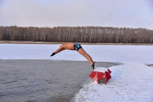 Songyuan, China. A winter swimmer dives into the icy waters of Songhua river