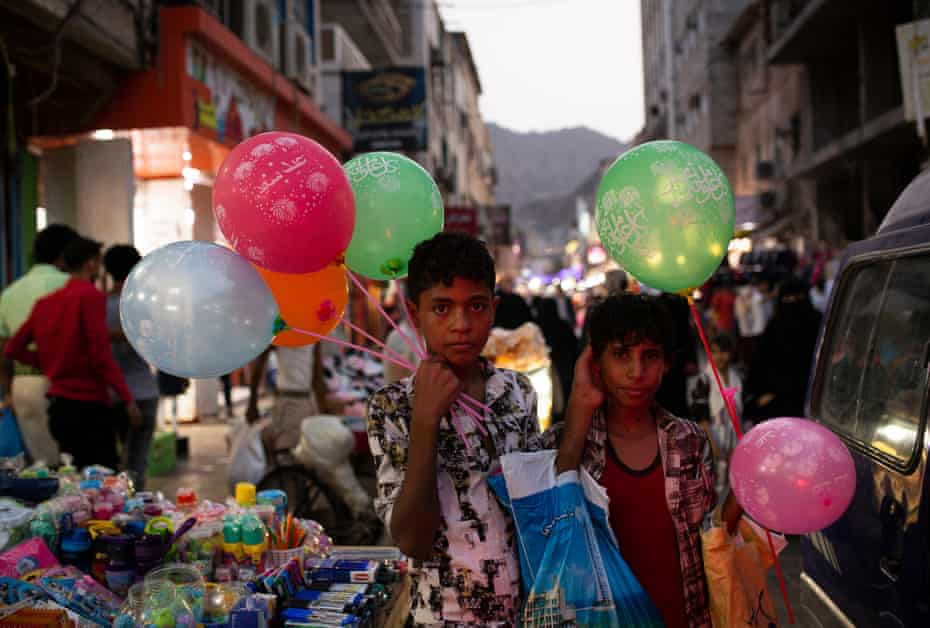 Two young boys selling balloons in the streets of Aden, on 8 September, 2019.