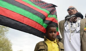 Activist PFK Boom, right, at the western district during protests in Baltimore.