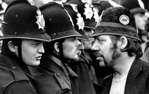 Striking miner facing a line of police at the Orgreave pit during the miners' strike in 1984