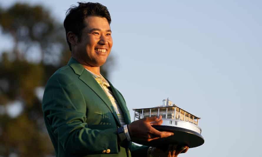 Hideki Matsuyama holds the trophy after winning the Masters on Sunday