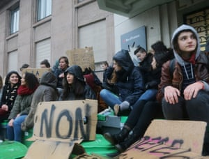 Students sit outside their high school in Paris, Wednesday , March 9, 2016. France's transport unions and youth organizations hold strikes, amid anger over proposed labor law changes that take aim at the 35-hour workweek and make layoffs easier. (AP Photo/Jacques Brinon)