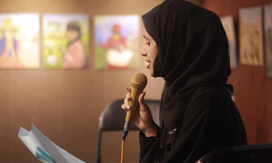 Poet Reem al-Shamiry at a live event in Sanaa