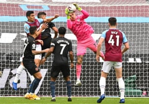 City kepeer Ederson claims the ball.