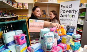 Volunteers and local mothers Kerry Wright and client Kelly Donaldson at CFINE food bank in Aberdeen, which is taking part in a pilot giving away sanitary products to women.