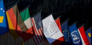 The national flags of several countries and a flag with the logo of the World Economic Forum (WEF)