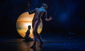 Semi naked male dancer looks upward silhouetted against a Jupiter-like planet, against which is also silhouetted a semi-naked female figure kneeling