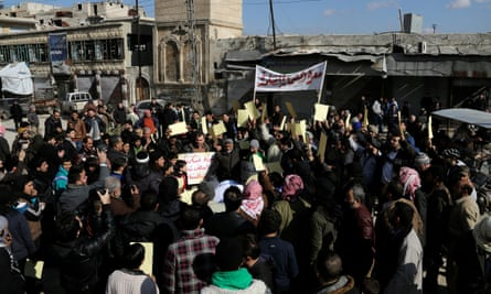 Syrians demonstrate against the regime's foreign supporters in Idlib.