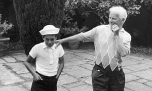Charlie Chaplin with his son Michael on the terrace at their home, the Manoir de Ban, Switzerland, circa 1957.