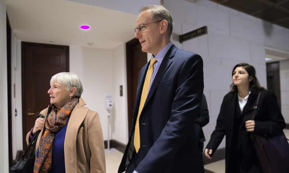 Mark Sandy arrives at the Capitol to testify in the impeachment inquiry in Washington DC, on 16 November.