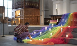 Zurich, Switzerland A mourner places his candle as Swiss LGBT activists hold a vigil for those killed and wounded in the Sunday mass shooting at a gay nightclub in Orlando