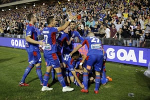 Newcastle Jets celebrate defeating Melbourne City.