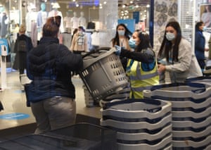 Early morning shoppers enter a Primark store in Birmingham
