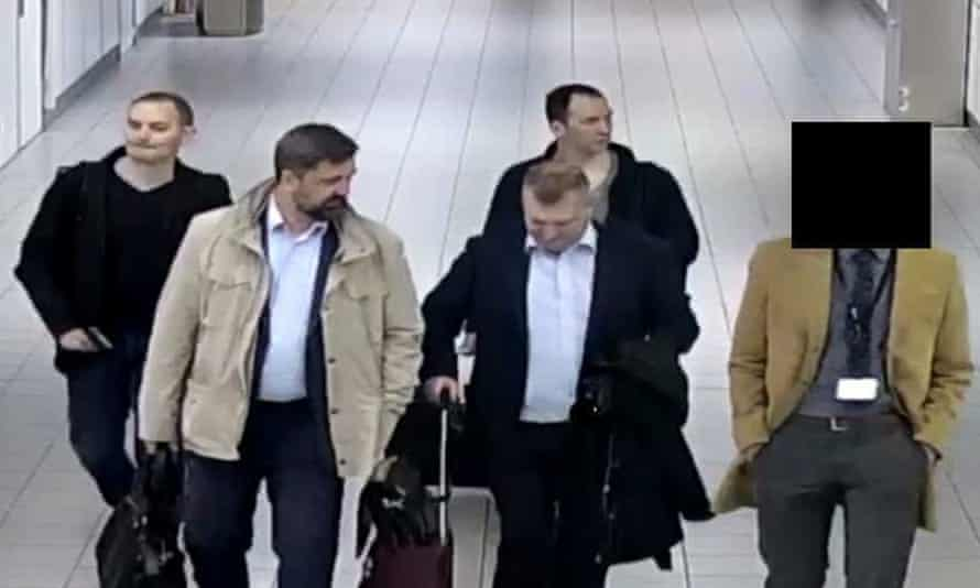 The four men pictured at Schiphol airport.