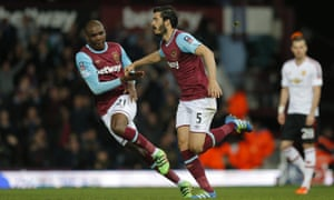 James Tomkins is congratulated by Angelo Ogbonna after pulling a goal back for West Ham with a brave diving header.