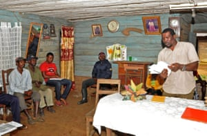 Nasako Besingi addresses residents of Iwei village at a meeting to provide information on the implications of the US company Herakles Farms' plans to develop a palm-oil plantation.