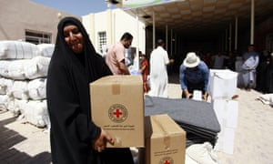 The Red Cross distributes aid to displaced Iraqis in Najaf.