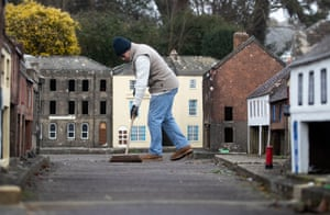 Wimborne, EnglandA volunteer sweeps a street at the Wimborne Model Town and Gardens in Dorset, during the annual winter maintenance. Each year the town and gardens shut in November until the following March to undertake refurbishment of the buildings and shop fronts of the 1/10th scale model, which shows the town's streets, shops and gardens as they looked in the 1950s