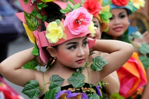 Bali, Indonesia<br>Children take part in a cultural parade during a New Year's Eve celebration