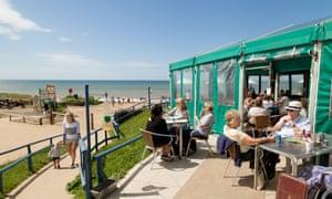 People eating at The Hive Beach Café, Burton Bradstock, Dorset England UK