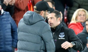 Liverpool manager Jürgen Klopp commiserates with his Everton counterpart Marco Silva.