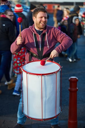 Steve Sudlow of the  Apollo Arts Street Band drummers playing outside the ground just before kick-off.