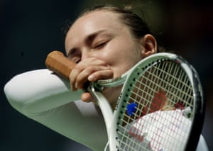 Switzerland's Martina Hingis wipes sweat from her face during her fourth round match against Italy's Rita Grande at the Australian Open in Melbourne January 22, 2001. Top-seeded Hingis won in straight sets 6-0 6-3, cruising into the quarter-finals