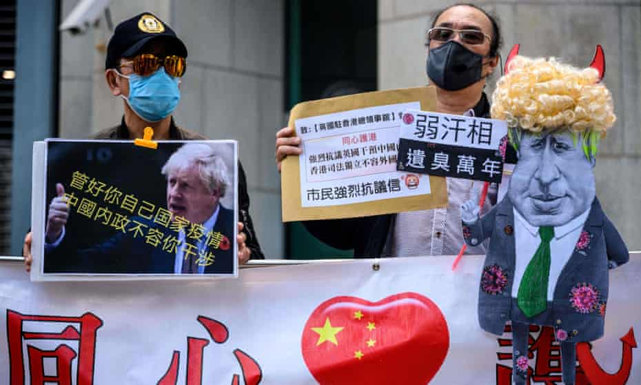 Pro-Beijing activists display a caricature of Boris Johnson outside the British consulate general in Hong Kong