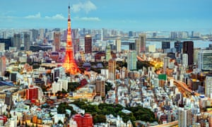 Tokyo Tower rises above the city.