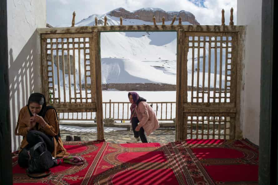 Nazira (left) fixes her make-up during a day out (including ice-skating and playing football on a frozen lake) at Band-a-Amir National Park during a weekend.