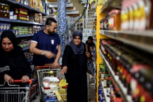 Food vouchers are used at a supermarket in Gaza