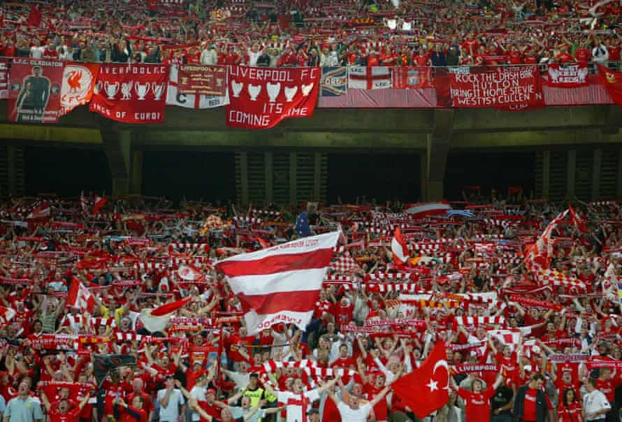 The Liverpool fans belt out You'll Never Walk Alone at half-time.
