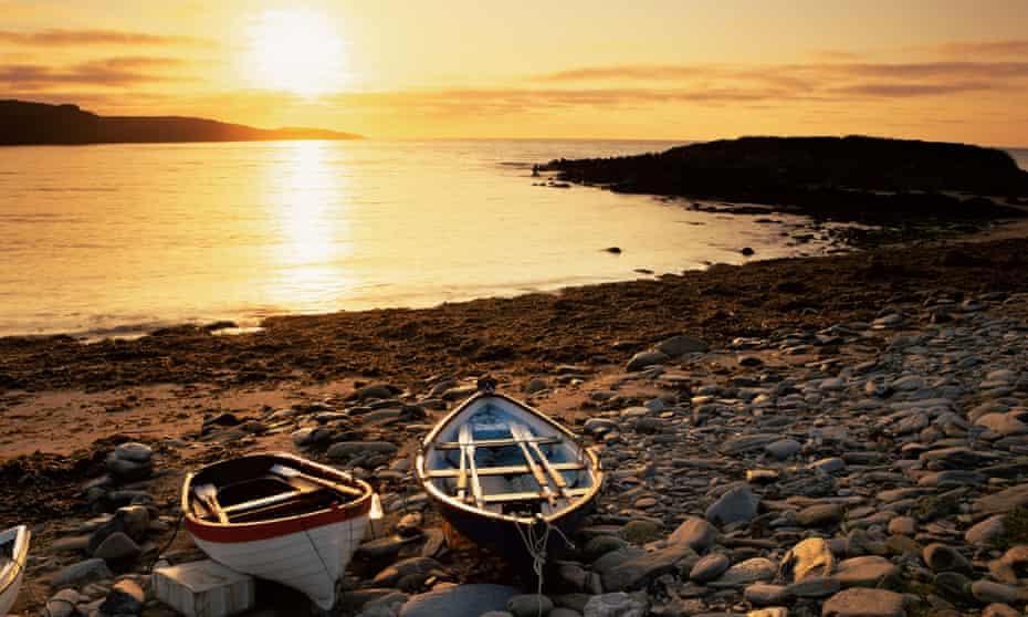 Boats on Norwick beach at sunrise, Unst, Shetland Islands, Scotland