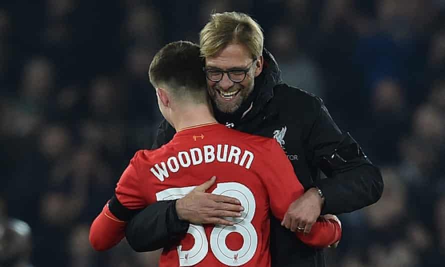 Jürgen Klopp congratulates Liverpool's 17-year-old goalscorer Ben Woodburn after his strike against Leeds at Anfield.