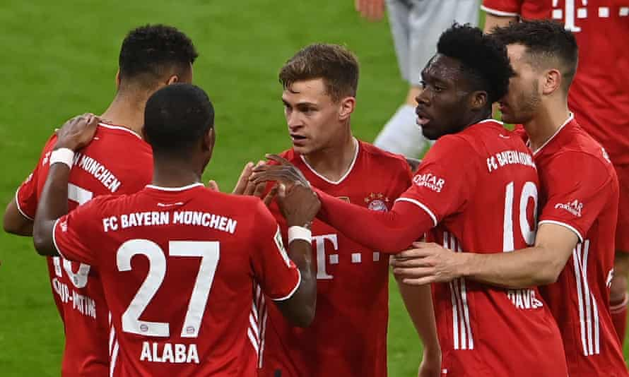 Joshua Kimmich celebrates with his Bayern teammates after scoring their second goal
