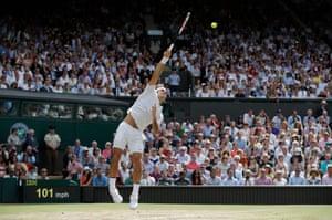 Roger Federer serves in the final game