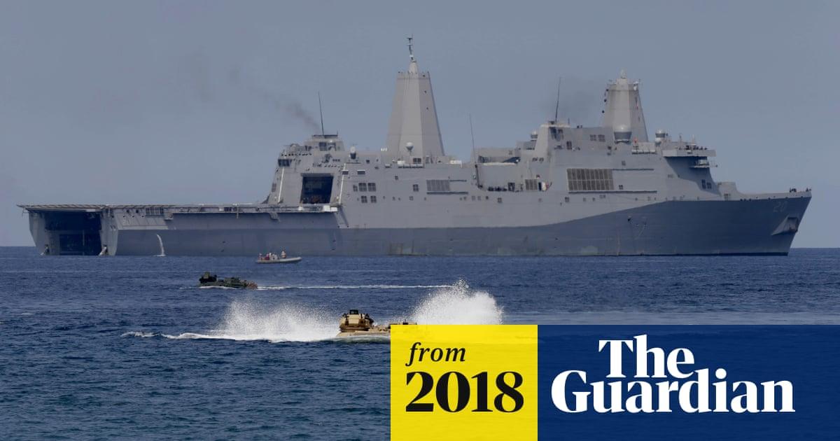 China vows action after US warship sails near South China