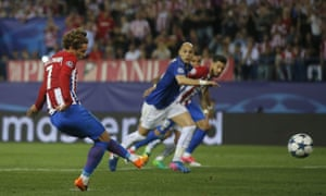 Atletico's Antoine Griezmann, shoots and scores from the penalty spot.