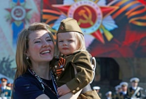 A girl is dressed in Red Army uniform for the Moscow ceremony