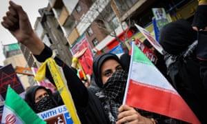 Iranians gather outside the former US embassy in Tehran.
